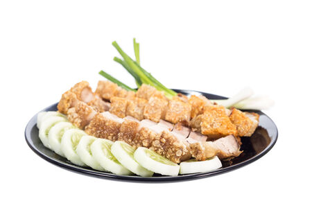 crispy pork with onion and cucumber in ceramic plate