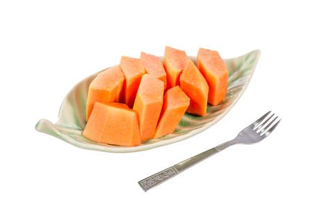cutaneous: ripe papaya in ceramic plate