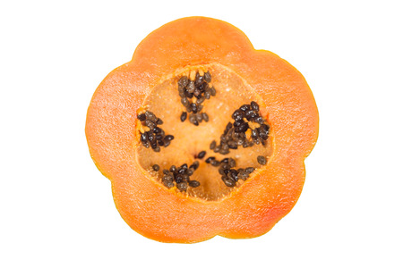 crosscut: crosscut of ripe papaya isolated on white