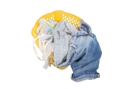 used clothes: used clothes in plastic basket isolated on white