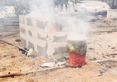 crucible: molten metal in the crucible