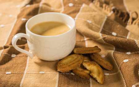 cup of espresso coffee and cookies on beautiful cotton tablecloth Stock Photo