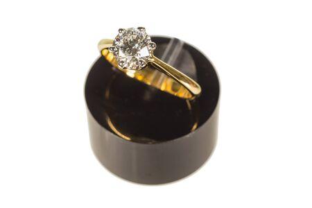 ring stand: wedding diamond ring on black plastic stand