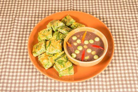 pennata: fried acacia pennata omelet with Chili paste thai style Stock Photo