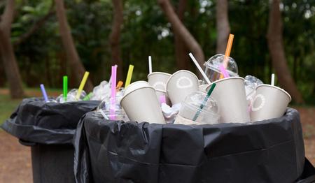 full refuse plastic and paper glass in plastic bin Reklamní fotografie