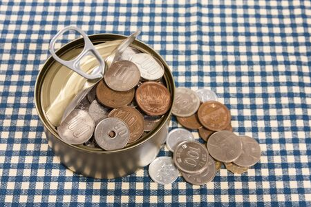 opened can with full of coin