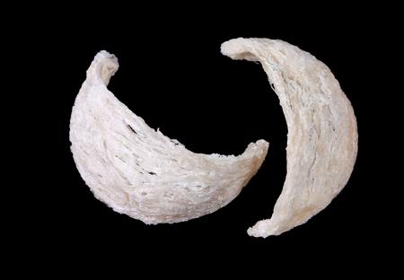 dry swiftlet nest isolated on black Reklamní fotografie