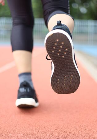 women jogging on sport track fucus on shoe tread Standard-Bild - 131702535