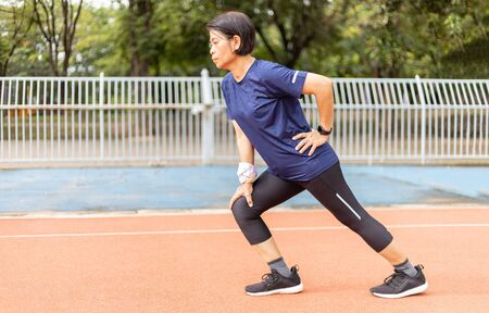 asia middle age women stretching her leg after jogging Standard-Bild - 131842762