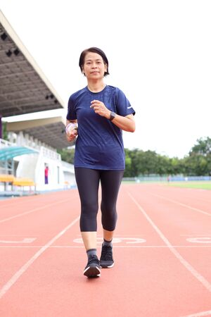 asia middle age women jogging on sport track Standard-Bild - 131843003