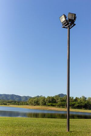 black post garden light with lake and forest and blue sky background Standard-Bild - 131703055