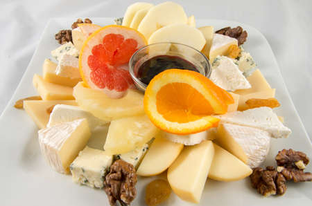 Fruit salad with cheese and walnuts.