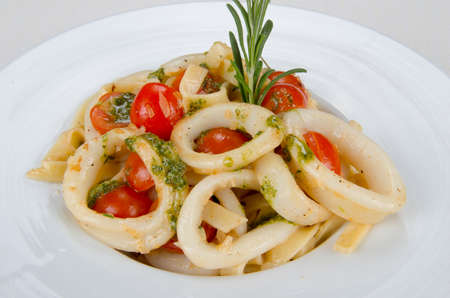stewed: Squid - stewed with tomato and vegetable sauce. Stock Photo