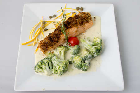 breading: Fish breaded with nuts and broccoli in cream sauce.