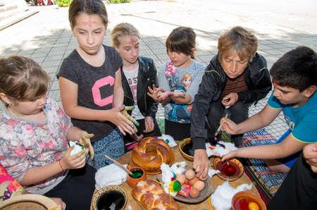 bulgaria girl: Preparation for Easter. Painting Easter eggs.