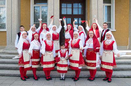 bulgaria girl: Veliko Tarnovo, Bulgaria - April 28.2016: People with traditional costumes of the region celebrate Easter.