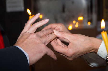 ritual: Ritual placement of wedding rings.