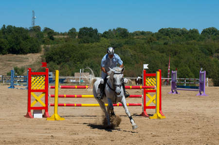 tourney: Arbanasi, Bulgaria - August 15.2016: Horseback riding. Jumping qualifier. Horse racing. This is a traditional event in the calendar of Bulgarian Equestrian Federation.