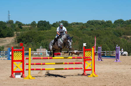 qualifier: Arbanasi, Bulgaria - August 15.2016: Horseback riding. Jumping qualifier. Horse racing. This is a traditional event in the calendar of Bulgarian Equestrian Federation.