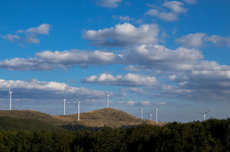 obtaining: Horizontal wind turbines.  Renewable energy. Obtaining electricity from wind. Preservation of nature.