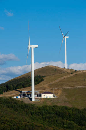 obtaining: Wind Turbines.  Renewable energy. Obtaining electricity from wind. Preservation of nature.