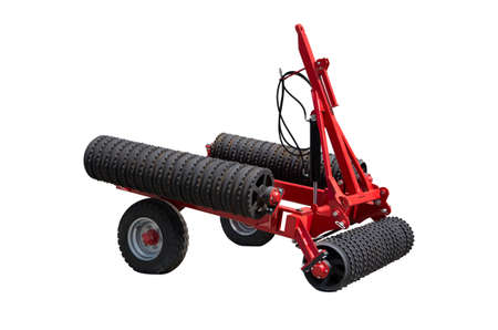 Tractor rollers used in agriculture before and after each seeding mainly for crushing large fragments of previous soil tillage sowing. When this is achieved, and substantially aligning the soil surface and the compaction of the soil after sowing. Stock Photo