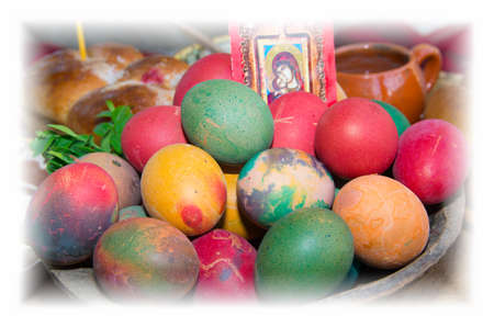 eastertime: Colorful easter eggs in a ceramic bowl. Ritual bread.