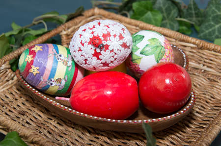 eastertime: Colorful easter eggs in a ceramic bowl.