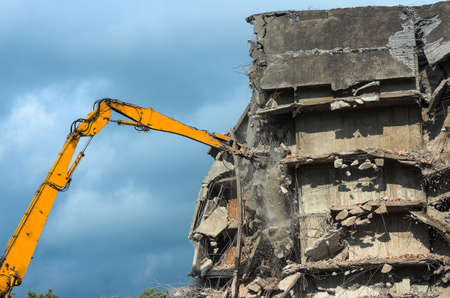 tearing down: Heavy equipment being used to tear tearing down building construction