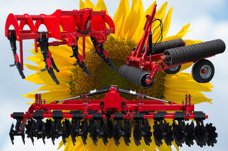 Farm equipment and implements - disc harrow, subsoiler, flat lifter and roller tractor trailer. Stock Photo