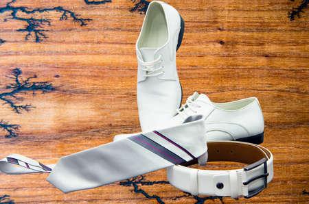 Elegant set: tie, mens shoes, leather belt.