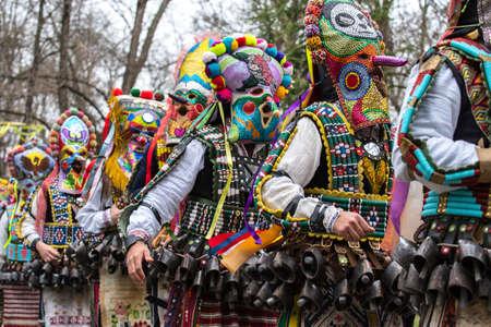 People in traditional carnival kuker costumes at Kukeri festival kukerlandia Yambol, Bulgaria