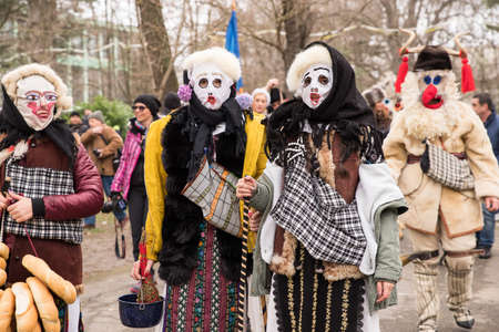 People in traditional carnival costumes at Kukeri festival kukerlandia Yambol, Bulgaria. Participants from Romania