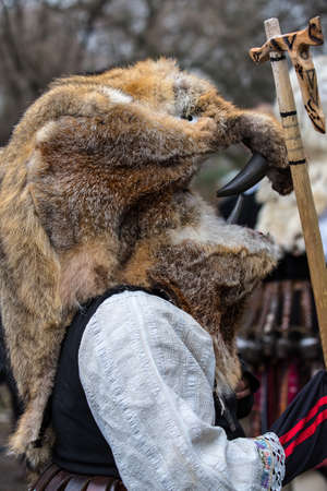 People in traditional carnival costumes at festival. Participants from Bulgaria, Romania and Macedonia. Kukeri and Mechkari