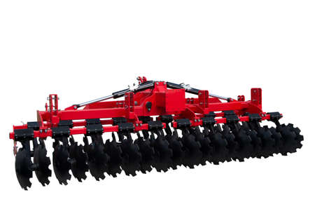 Disc harrow trailer for a farming tractor. Metal discs to break ground. Isolated on white.