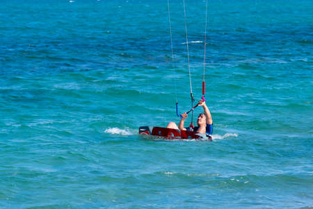 Shkorpilovtsi, Bulgaria - June 29, 2018: Kiteboarding Sports. Recreational activities, hobbies, water sports, and fun in summer. Man kitesurfing on beach water