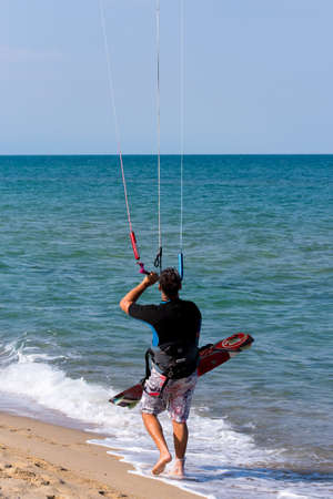 Shkorpilovtsi, Bulgaria - June 29, 2018: Man kiteboarding at the sea beach. Kiteboarding, Kitesurfing Sports. Recreational activities, hobbies, water sports, and fun in summer