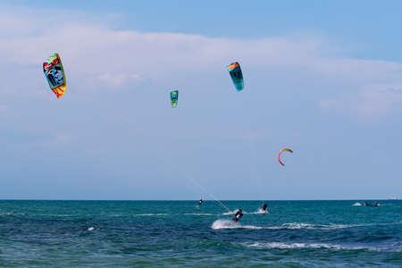 Shkorpilovtsi, Bulgaria - June 29, 2018: Kiteboarding Sports. Recreational activities, hobbies, water sports, and fun in summer. Kitesurfing Extreme sports in sea waves