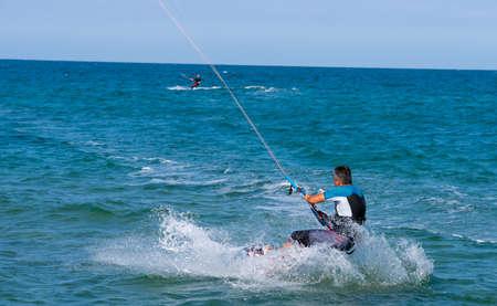 Shkorpilovtsi, Bulgaria - June 29, 2018: Kiteboarding Sports. Recreational activities, hobbies, water sports, and fun in summer. Kitesurfing. Extreme sports in sea waves.