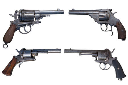 Four antique revolvers isolated on white background.