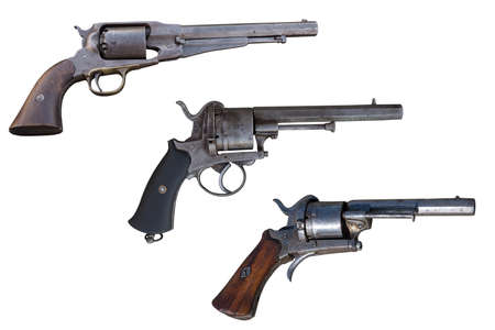 Three old revolvers. Ancient weapon.