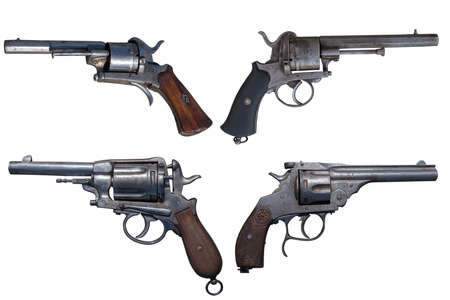 Antique firearms. Vintage revolver, pistol isolated.