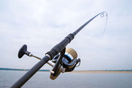 Fishing rod with reel close-up. 스톡 콘텐츠