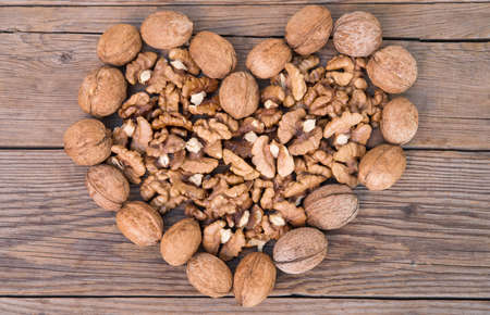 Walnuts whole and nuts in the shape of heart