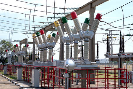 Delivery of electricity. High-voltage substation with power line and Insulator