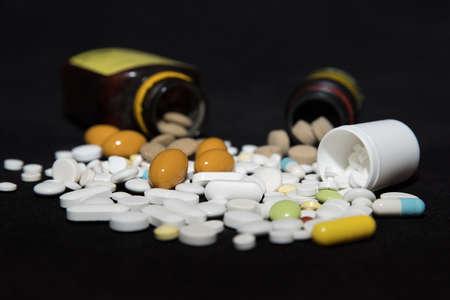 Pills spilling out of pill bottles 免版税图像