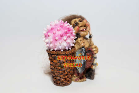 Troll with the covid-19 virus in the basket. 免版税图像
