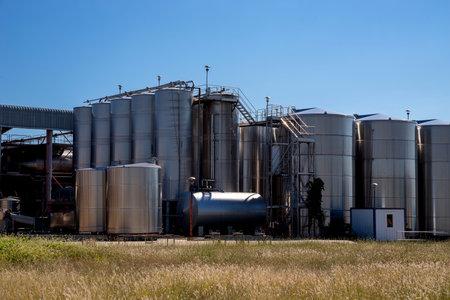 Vertical winemaking tanks.