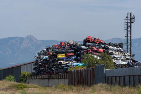 Pile of old cars ready for recycling