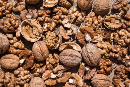 scattered whole walnuts and nuts